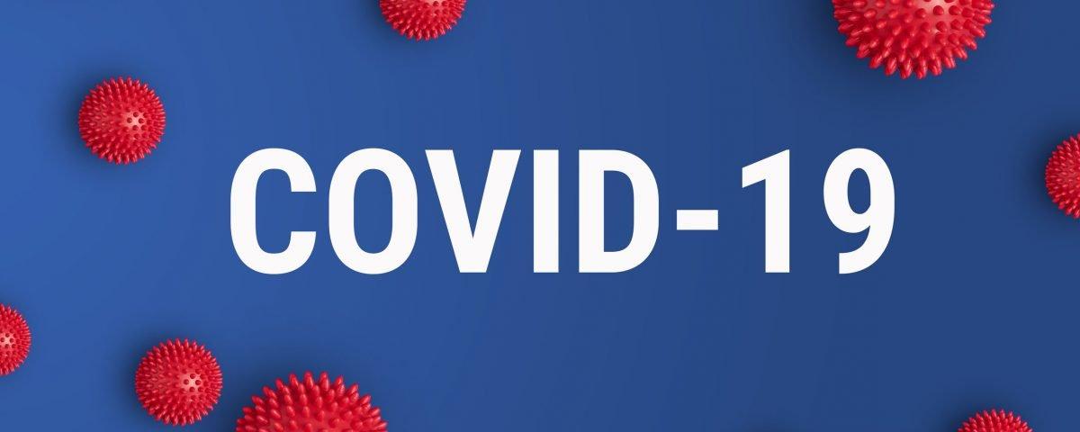 Health care providers following COVID-19 safety precautions.